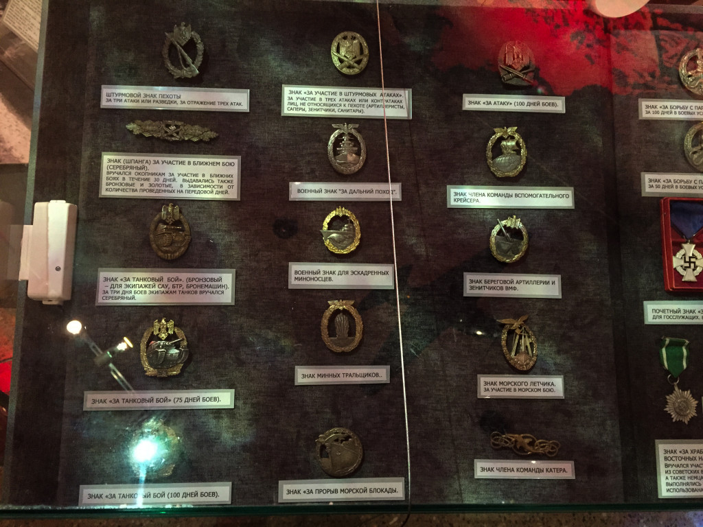 Looted Nazi awards. Notice the security sensor, Hitler's Gold Party Badge was put on display in Moscow in 2005 and was stolen after someone smashed the case with a hammer and ran off with it.