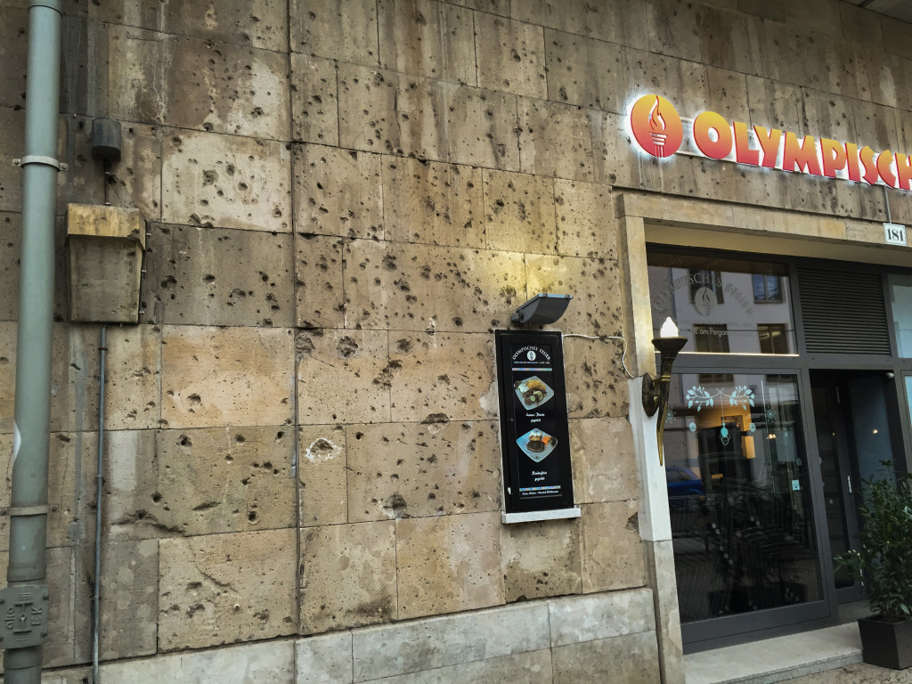 While walking around I noticed some damage that is still present from the Battle of Berlin. This damage is most likely from an artillery shell exploding nearby. This was a restaurant under a railway, more prominent buildings have been completely repaired.